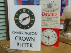 TWO ADVERTISING WALL CLOCKS, ONE FOR DEWARS WHISKY AND THE OTHER FOR CHARINGTON CROWN BITTER.