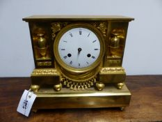 A 19TH.C. GILT BRONZE ORMOLU CASED MANTLE CLOCK WITH WHITE ENAMEL DIAL AND TWO TRAIN UNSIGNED