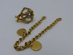 A 9CT YELLOW GOLD BRACELET WITH TWO ENGRAVED DISCS TOGETHER WITH A YELLOW METAL AND STONE SET BROOCH
