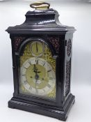 A GOOD LATE 18TH.C.BRACKET CLOCK IN EBONISED CASE WITH PIERCED SIDE PANELS. GILT BRASS ARCH TOP DIAL