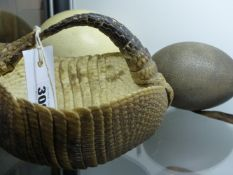 A TAXIDERMY ARMADILLO HIDE MOUNTED AS A SEWING BASKET TOGETHER WITH AN OSTRICH AND AN EMU EGG.
