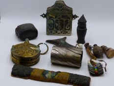 A GROUP OF AFRICAN AND MIDDLE EASTERN ARTIFACTS TO INCLUDE A BRASS POWDER FLASK, A LARGE SILVER