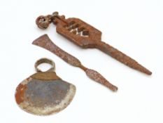 AN AFRICAN NGIGLIO FINGER KNIFE- KENYA, A BELL FINGER RING, A MIDDLE EASTERN IRON CLASP KEY AND A
