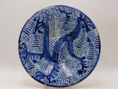AN ANTIQUE BLUE AND WHITE DELFT POTTERY BOWL DECORATED WITH STYLISED GRIFFIN.29CM DIA.