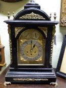 A 19TH.C.LARGE BRACKET CLOCK WITH THREE TRAIN MOVEMENT CHIMING ON 8 BELLS AND GONG IN EBONISED AND