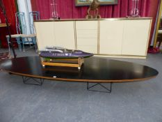 A HERMAN MILLER SURF BOARD OVAL COFFEE TABLE, DESIGNED BY CHARLES AND RAY EAMES.
