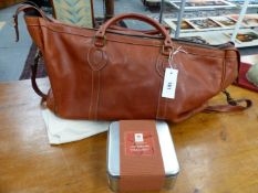 A GOOD QUALITY CONNELLY HIDE HOLDALL.