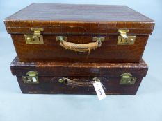 A LARGE EARLY 20TH. CENTURY CROCODILE HIDE SUITCASE WITH PIGSKIN LEATHER INTERIOR AND A SIMILAR SILK