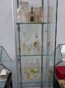 VARIOUS PERFUME BOTTLES TO INCLUDE TABAC BLOND, GUERLAIN,ETC