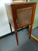 A PAIR OF FRENCH WALNUT BEDSIDE CABINETS WITH CANE PANEL DOORS.