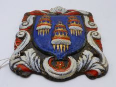 A 19TH CENTURY CAST IRON PLAQUE DEPICTING THE ARMS OF THE DRAPERS COMPANY.