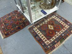 TWO ANTIQUE PERSIAN TRIBAL BAGFACES, EACH WITH BROCADED ENDS.