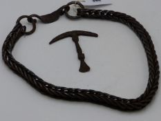 AN INTERESTING WROUGHT STEEL ROPE BELT PROBABLY PERSIA 18TH/ 19TH CENTURY TOGETHER WITH A FLINT