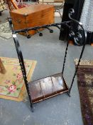 AN ARTS AND CRAFTS WROUGHT IRON AND COPPER STICKSTAND.