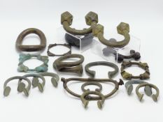 "A GROUP OF EIGHTEEN AFRICAN COPPER AND MANILA ""SLAVE BANGLES"" AND OTHER CURRENCY BRACELETS."