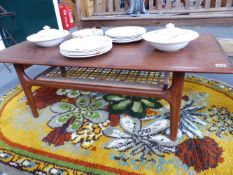 A MID 20TH.CENTURY TEAK COFFEE TABLE WITH CANED UNDERTIER. 120CMS.WIDE
