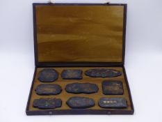 A CHINESE CASED SET OF NINE INK BLOCKS DEPICTING DEITIES.