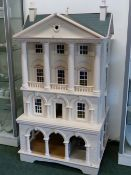 A VERY LARGE MODEL DOLL'S HOUSE IN THE FORM OF AN IMPRESSIVE GEORGIAN TOWN HOUSE.
