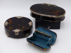 A TORTOISE SHELL PURSE WITH WHITE METAL LOCKING HASP AND SCROLLWORK DECORATION ( WIDTH APPROX
