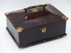 A CANTED LIDDED YELLOW METAL MOUNTED TORTOISE SHELL BOX ON IVORY FEET COMPLETE WITH WORKING LOCK AND