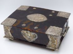 A HEAVILY STYLIZED WHITE METAL FLORAL REPOUSSE GENEROUSLY MOUNTED TORTOISE SHELL BOX. (WIDTH