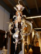 A LATE 19TH.C.WROUGHT BRASS CHANDELIER IN THE MANNER OF W A S BENSON.