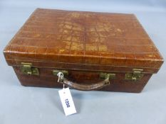 A CROCODILE LEATHER TRAVELLING VANITY CASE, PART FITTED WITH BLUE ENAMEL MONOGRAMMED SILVER AND