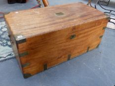 A CAMPHORWOOD CAMPAIGN CHEST WITH BRASS BINDINGS AND CARRYING HANDLES. 105CMS.WIDE.
