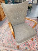 """A GOOD MID CENTURY HOWARD KEITH """"BAMBINO"""" CHAIR WING ARMCHAIR WITH HK LABEL."""