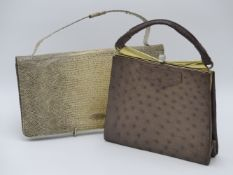 AN OSTRICH SKIN HANDBAG AND A SNAKESKIN HANDBAG OF QUALITY.