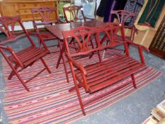 A VINTAGE FOLDING HARDWOOD PATIO TABLE, FOUR CHAIRS AND A BENCH.