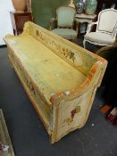 A CONTINENTAL PAINT DECORATED BOX SEAT SETTLE. 152CMS.WIDE.