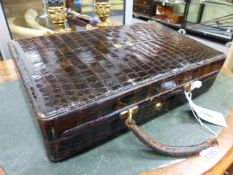 A SMALL CROCODILE SKIN DRESSING CASE WITH BRAMAH LOCK. (WIDTH 38 CMS.).