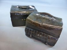 AN ANTIQUE GREEN STAINED CROCODILE SKIN DRESSING OR VANITY CASE WITH NICKEL MOUNTS, MAKERS STAMP