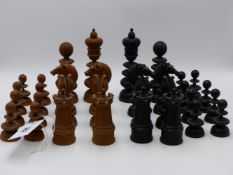 AN ANTIQUE BOXWOOD AND EBONY TURNED AND CARVED CHESS SET, THE KINGS 16CMS HIGH.
