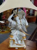 A GOOD QUALITY POTTERY AND GILT BRASS TABLE LAMP SURMOUNTED WITH FIGURE OF A WARRIOR WITH HARROD'S