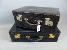 A GOOD ASPREY LONDON CROCODILE SKIN SUITCASE WITH GILT BRASS FITTINGS TOGETHER WITH A SMALLER