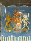A FRAMED VICTORIAN BEAD WORK PANEL OF THE ROYAL COAT OF ARMS.