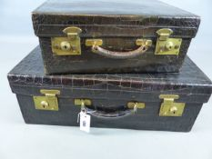 AN ANTIQUE GREEN STAINED CROCODILE SKIN VANITY CASE, UNFITTED RETAINING CANVAS OUTER COVER