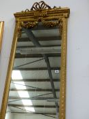 AN IMPRESSIVE PAIR OF TALL GILT FRAMED FRENCH STYLE HALL MIRRORS WITH FLORAL SWAG DECORATION. APPROX