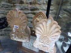 A GROUP OF THREE ANTIQUE TERRACOTTA FINIALS.