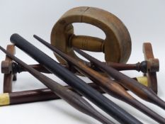 A GROUP OF VARIOUS TREEN TO INCLUDE A HAT RIM STRETCHER, TWO RING SIZERS, VARIOUS ROLLING RULES,