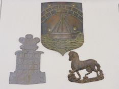 A 19TH CENTURY BRONZE WALL PLAQUE WITH STYLISED BOAT TOGETHR WITH A LEAD FIRE MARK AND A LEAD