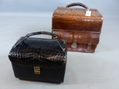 AN EARLY 20TH. CENTURY CROCODILE HIDE SKIN GLADSTONE TYPE DRESSING CASE WITH SILK LINING TOGETHER