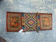 AN UNUSUAL ANTIQUE PERSIAN DOUBLE FACE BIDJAR SADDLE BAG WITH BROCADE EDGES.