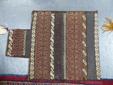 TWO TRIBAL BELOUCH SADDLE BAGS AND A CAUCASIAN FLATWEAVE PANEL.