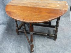 AN EARLY 18th.C.OAK COTTAGE GATELEG TABLE ON TURNED SUPPORT AND STRETCHERS. L.106cms.