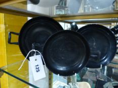 A GROUP OF THREE ANTIQUE GREEK ATTIC BLACK POTTERY SHALLOW BOWLS OR KYLIX WITH SHAPED LOOP HANDLES