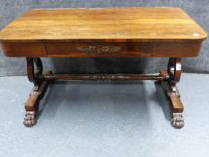 A LATE REGENCY ROSEWOOD LIBRARY TABLE WITH APRON DRAWER AND LYRE END SUPPORTS ON PAW FEET. W.
