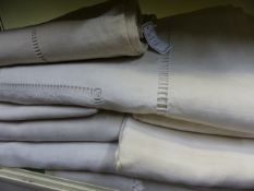 A MIXED LOT OF LINEN EMBROIDERED AND BORDERED TABLE CLOTHS, MOST BEARING MONOGRAMS.